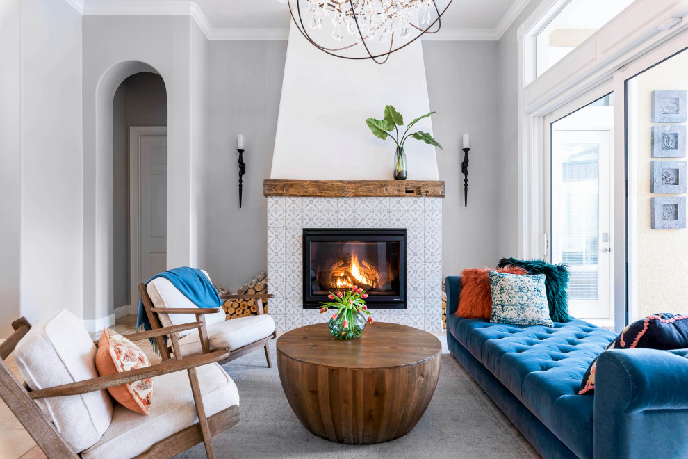 Inspiration for a coastal open concept living room remodel in Orlando with gray walls, a standard fireplace and a tile fireplace
