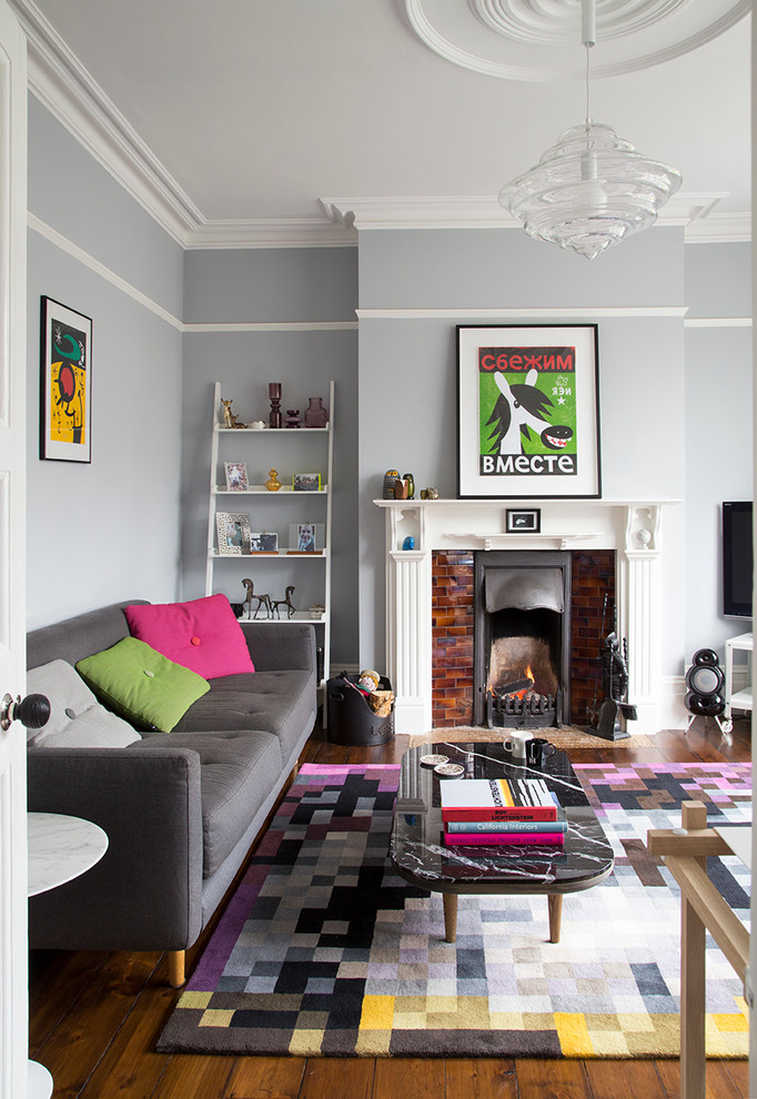 Mid-sized transitional enclosed dark wood floor living room photo in London with a standard fireplace, blue walls and a tile fireplace