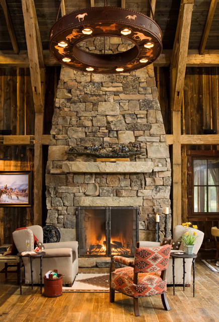 Inspiration for a rustic living room remodel in Denver with a stone fireplace