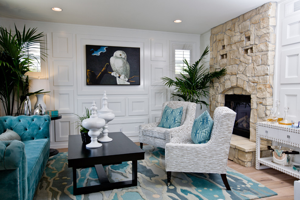 Example of a trendy formal living room design in Orange County with a standard fireplace, a stone fireplace and no tv