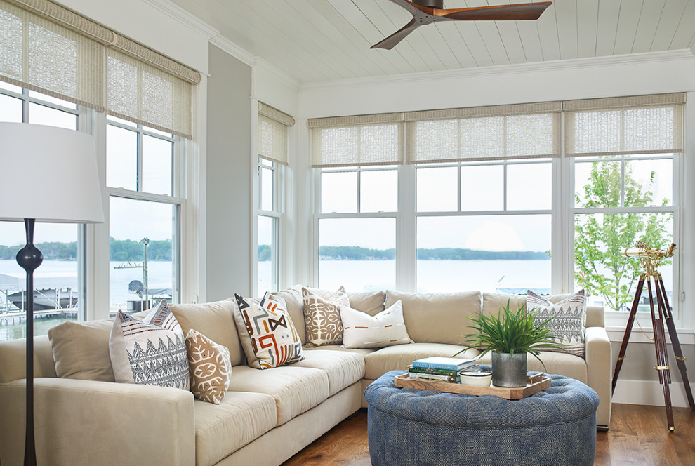 Living room - coastal medium tone wood floor living room idea in Grand Rapids with white walls