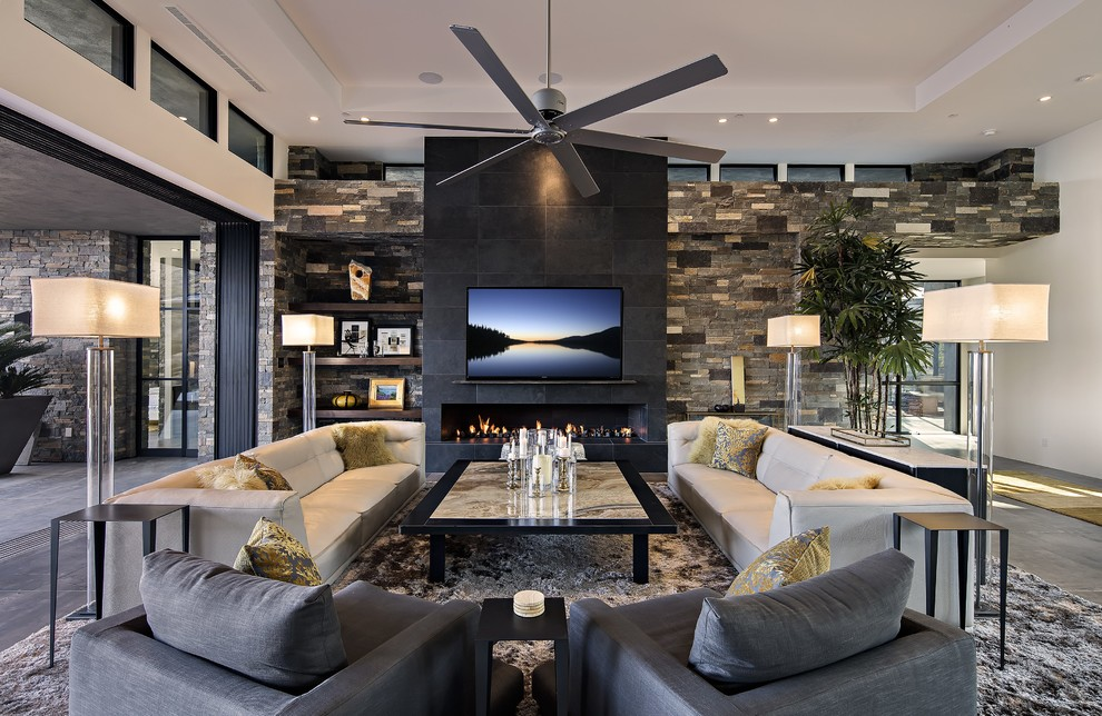 Living room - large contemporary open concept porcelain tile living room idea in Phoenix with a ribbon fireplace, a stone fireplace, a wall-mounted tv and white walls