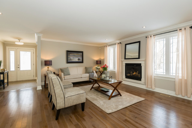 High end home staging in ottawa by capital home staging design transitional living room for Capital home staging and design