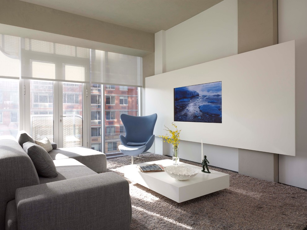 Living room - modern living room idea in New York with white walls and a wall-mounted tv