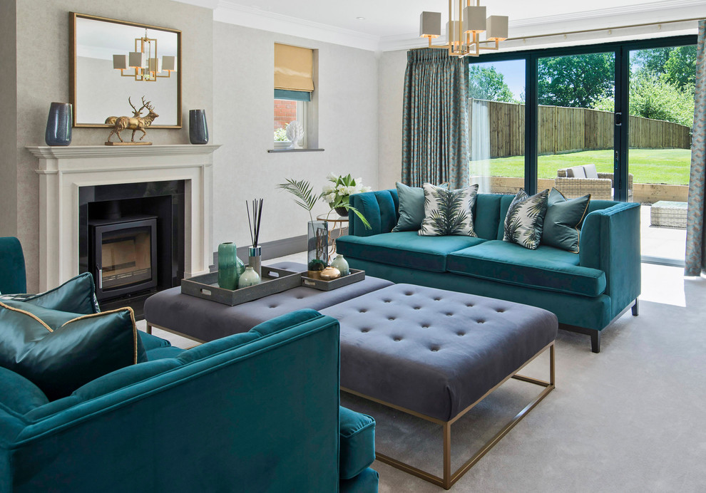 Inspiration for a mid-sized transitional formal carpeted and gray floor living room remodel in Surrey with gray walls and a wood stove