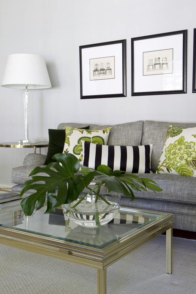 Trendy living room photo in Melbourne with white walls