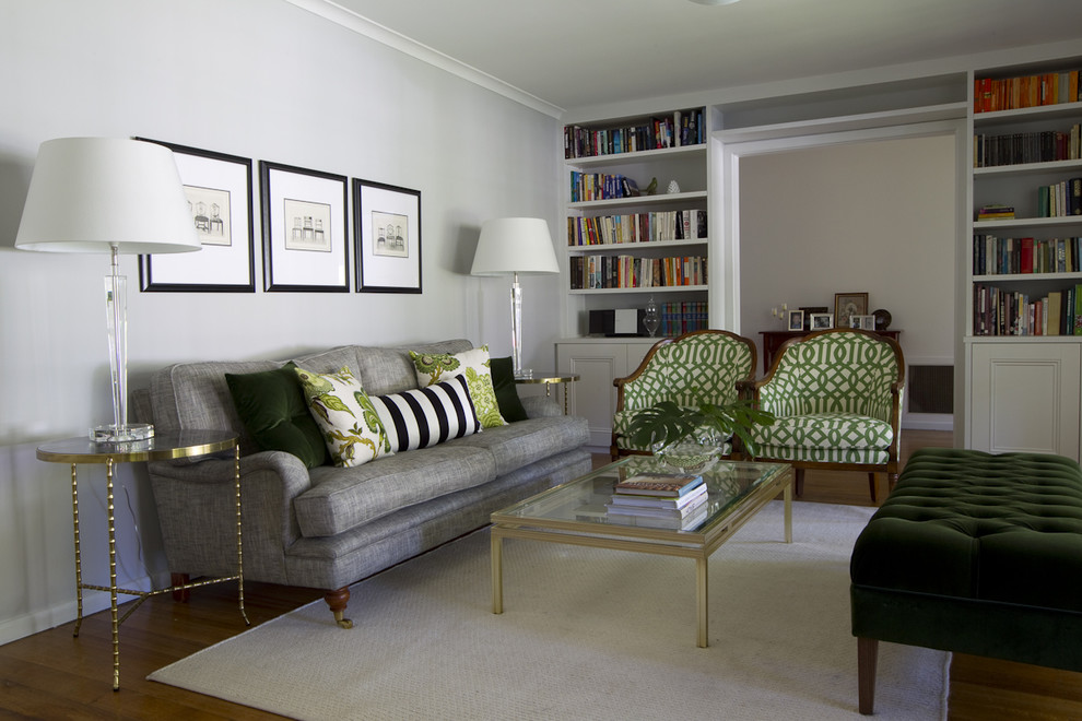 Living room library - contemporary enclosed medium tone wood floor living room library idea in Melbourne with gray walls