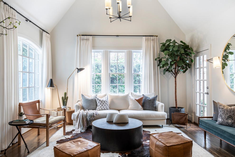 Inspiration for a transitional medium tone wood floor and brown floor living room remodel in Dallas with white walls