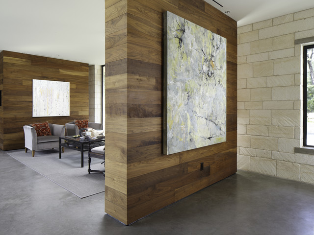 Example Of A Trendy Concrete Floor Living Room Design In Austin