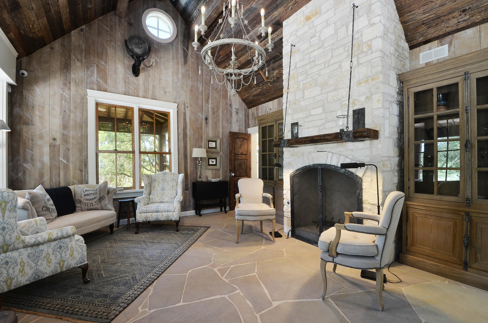 Inspiration for a small rustic limestone floor living room remodel in Austin with a standard fireplace and a stone fireplace