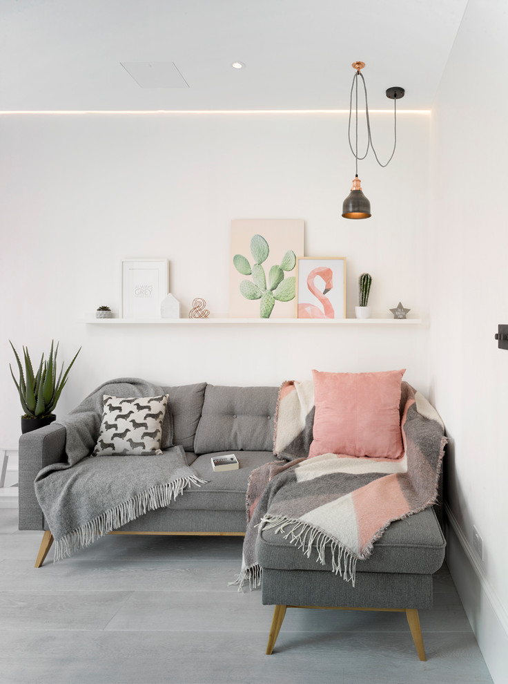 Example of a danish gray floor living room design in London with white walls