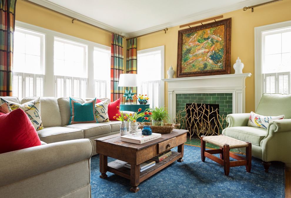 Mid-sized eclectic enclosed medium tone wood floor and brown floor living room photo in Little Rock with yellow walls, a tile fireplace and a standard fireplace