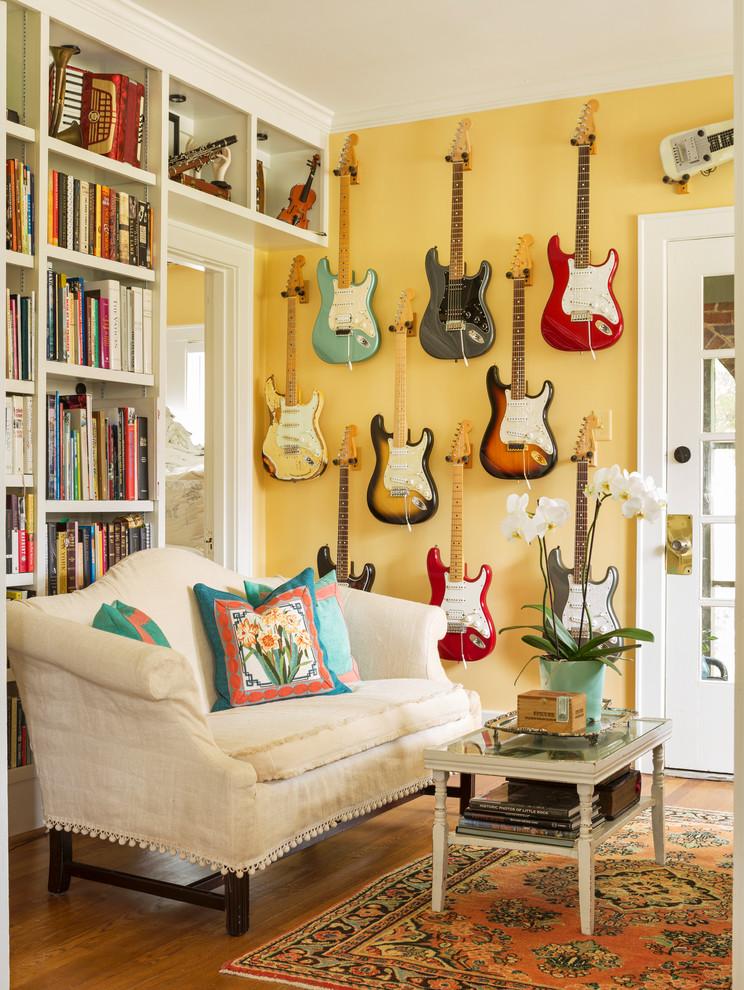 Living room - eclectic medium tone wood floor and brown floor living room idea in Little Rock with yellow walls