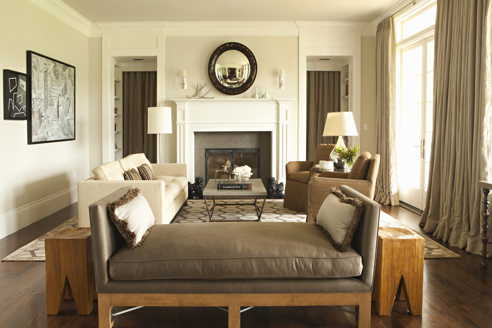 Example of a transitional dark wood floor living room design in Los Angeles with beige walls and a standard fireplace
