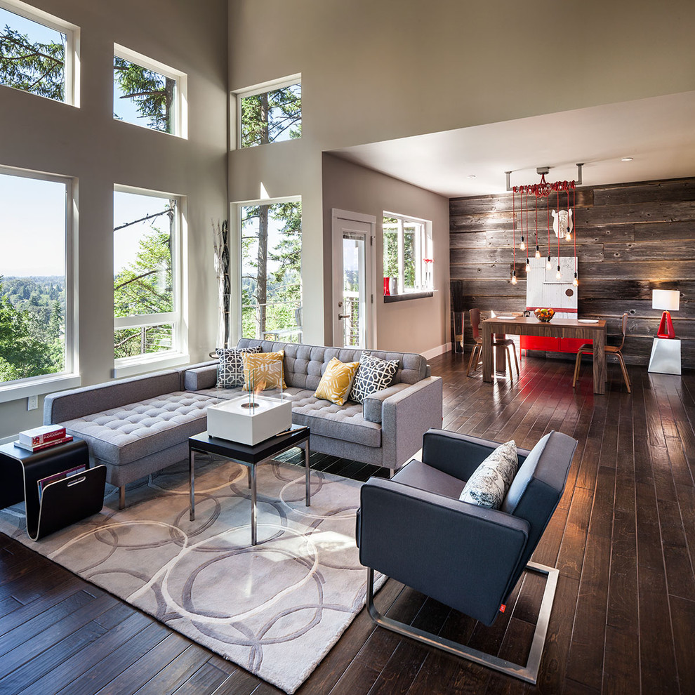 Living room - large contemporary open concept dark wood floor living room idea in Portland with gray walls