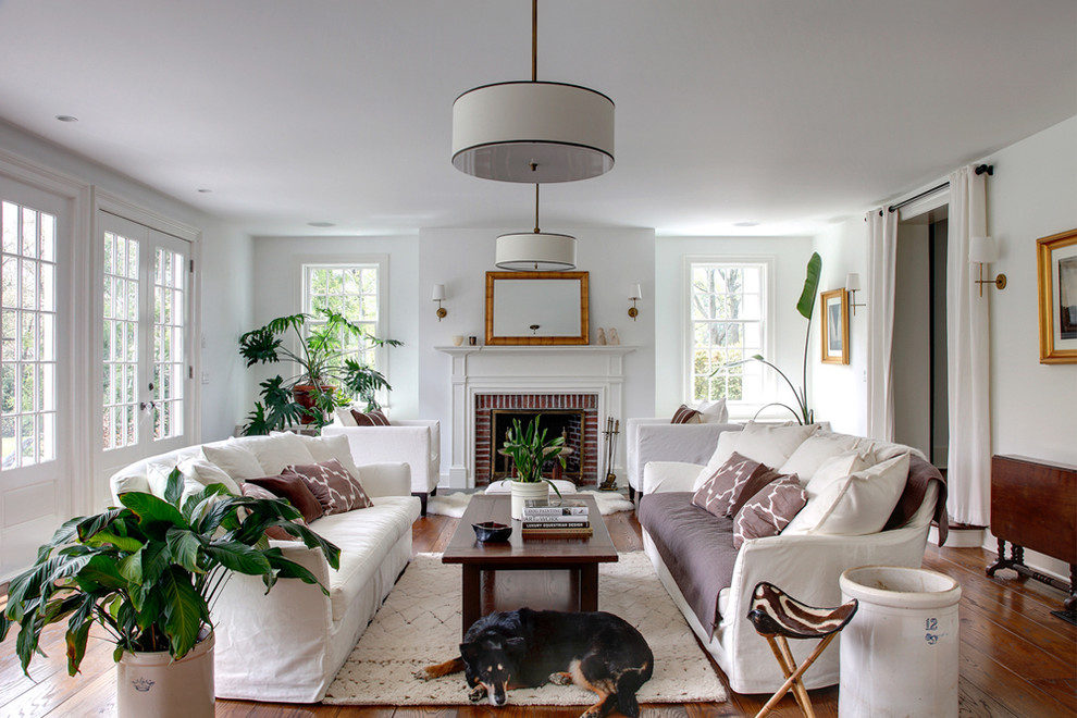 Large elegant living room photo in Bridgeport with white walls, a standard fireplace and a brick fireplace