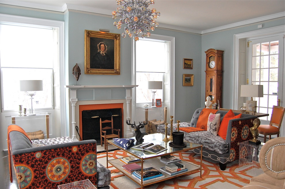 Example of a transitional living room design in Boston with blue walls and a standard fireplace