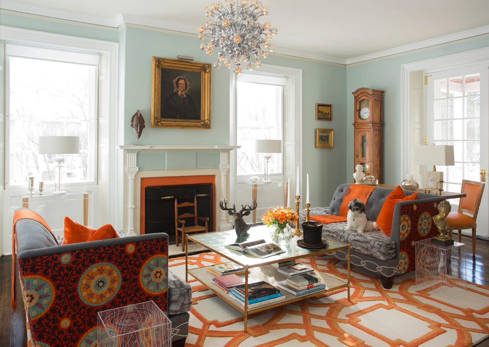 Inspiration for a victorian formal living room remodel in San Francisco with blue walls and a standard fireplace