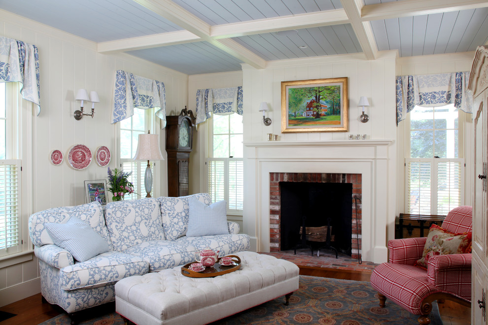 Mid-sized cottage formal and enclosed living room photo in Boston with white walls, a standard fireplace, a brick fireplace and no tv
