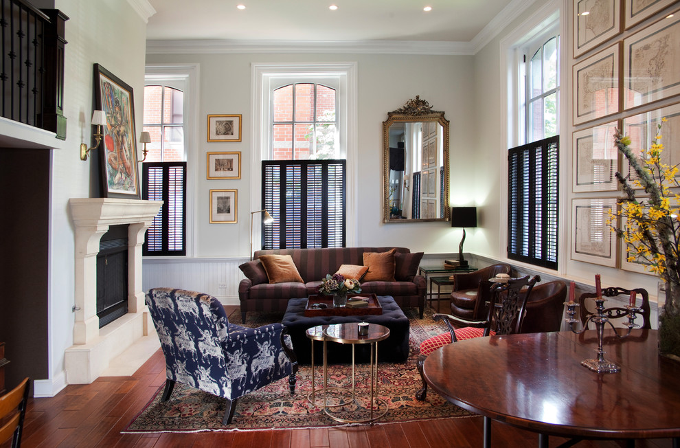 Inspiration for a mid-sized timeless formal and open concept dark wood floor and brown floor living room remodel in Chicago with a standard fireplace, no tv and beige walls