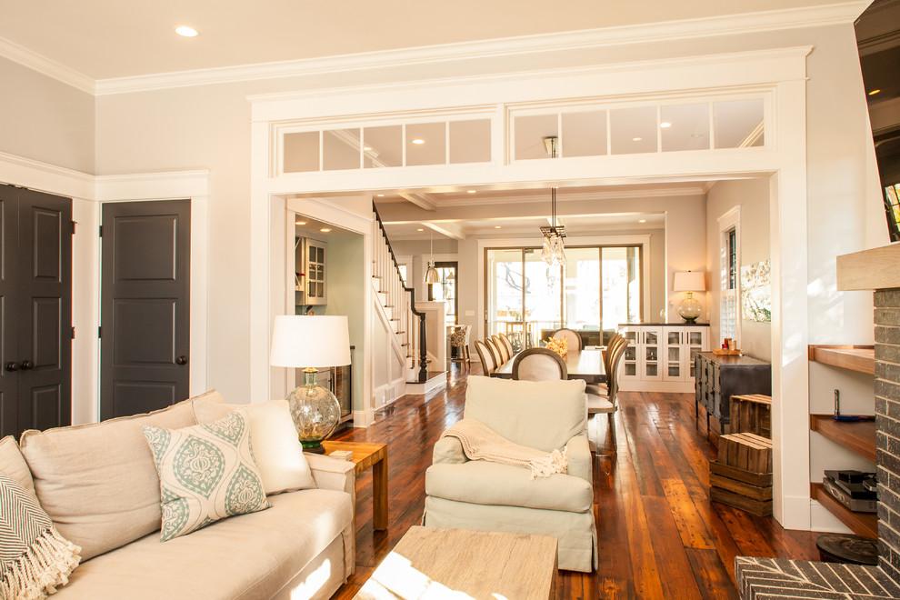 Inspiration for a craftsman enclosed medium tone wood floor living room remodel in Atlanta with beige walls