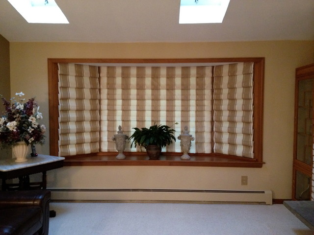 Hobbled roman shade for bay window Window treatments for bay window in living room
