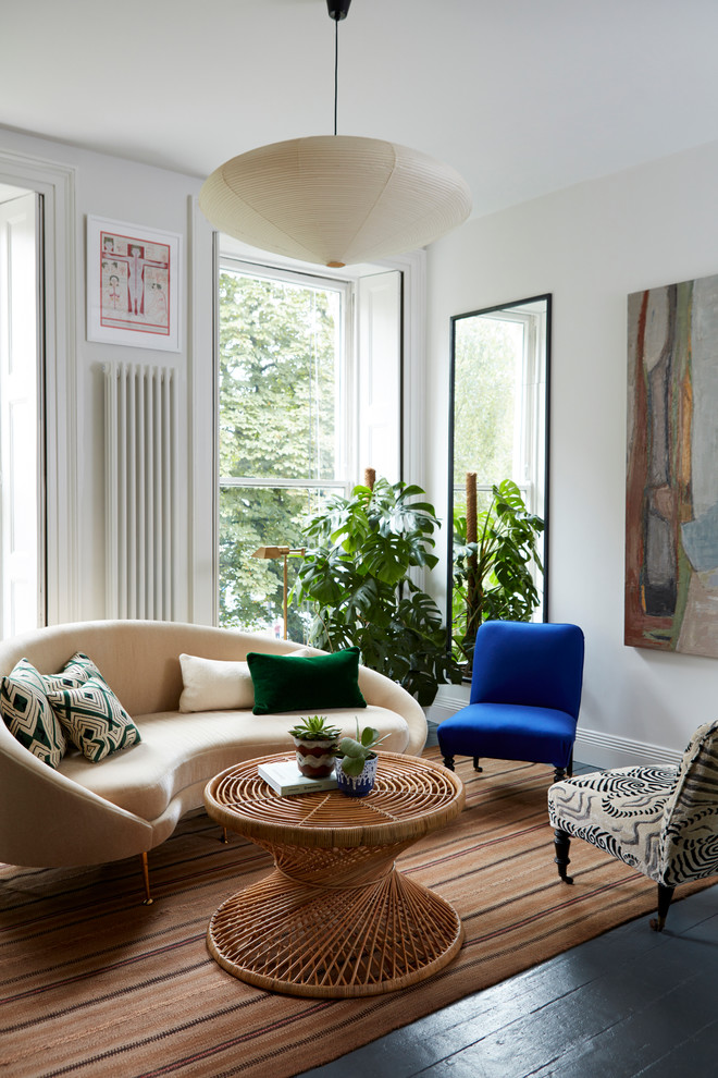 Example of a small eclectic formal dark wood floor living room design in London with white walls