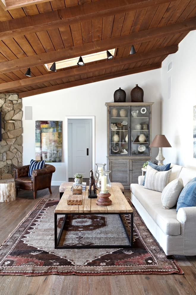 Inspiration for a timeless dark wood floor living room remodel in Los Angeles with white walls