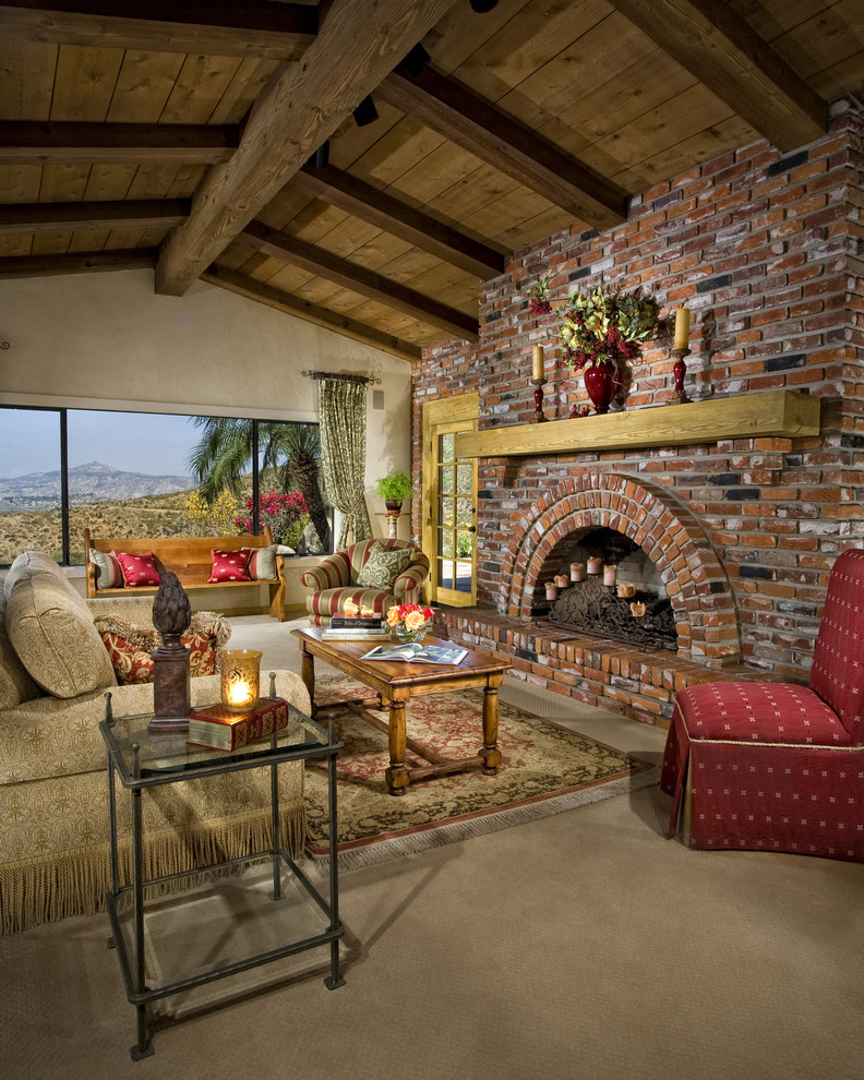 Living room - rustic living room idea in San Diego with a brick fireplace