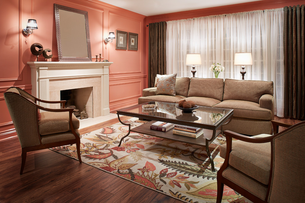 Inspiration for a mid-sized timeless formal and enclosed dark wood floor and brown floor living room remodel in Atlanta with pink walls, a standard fireplace, a stone fireplace and no tv