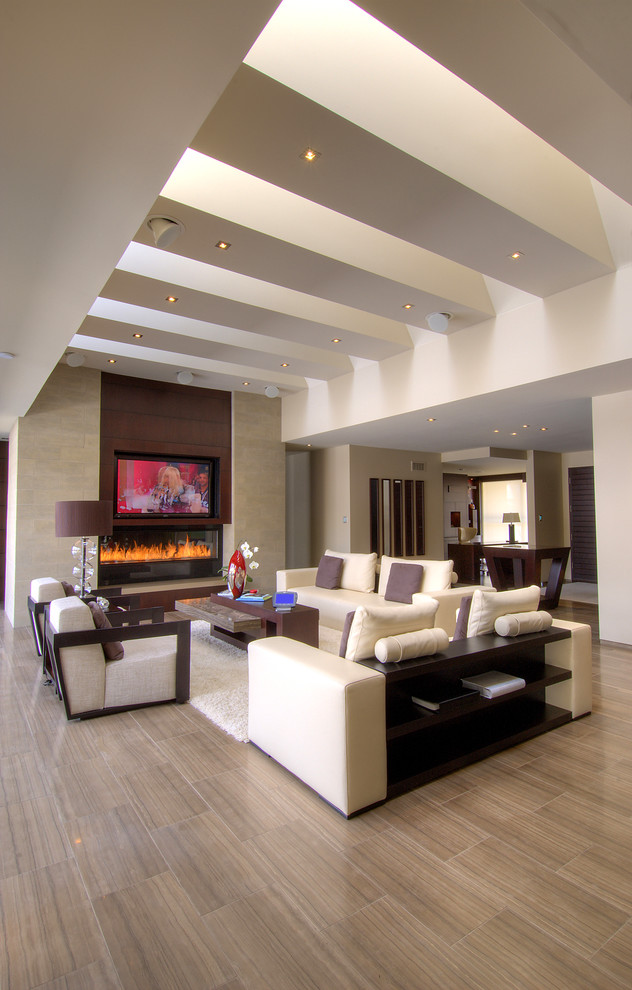 Large trendy open concept and formal porcelain tile and brown floor living room photo in Toronto with beige walls, a ribbon fireplace, a stone fireplace and a media wall
