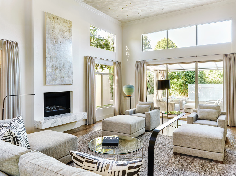 Mid-sized trendy open concept dark wood floor living room photo in Phoenix with white walls, a standard fireplace, a plaster fireplace and no tv