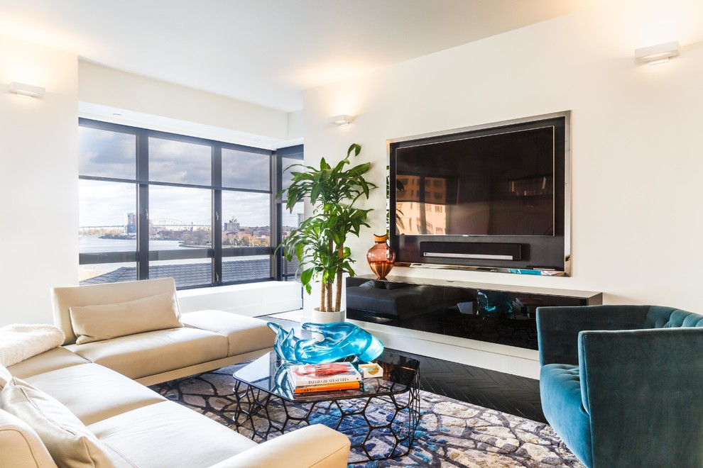 Example of a trendy formal and enclosed painted wood floor and black floor living room design in New York with beige walls and a wall-mounted tv