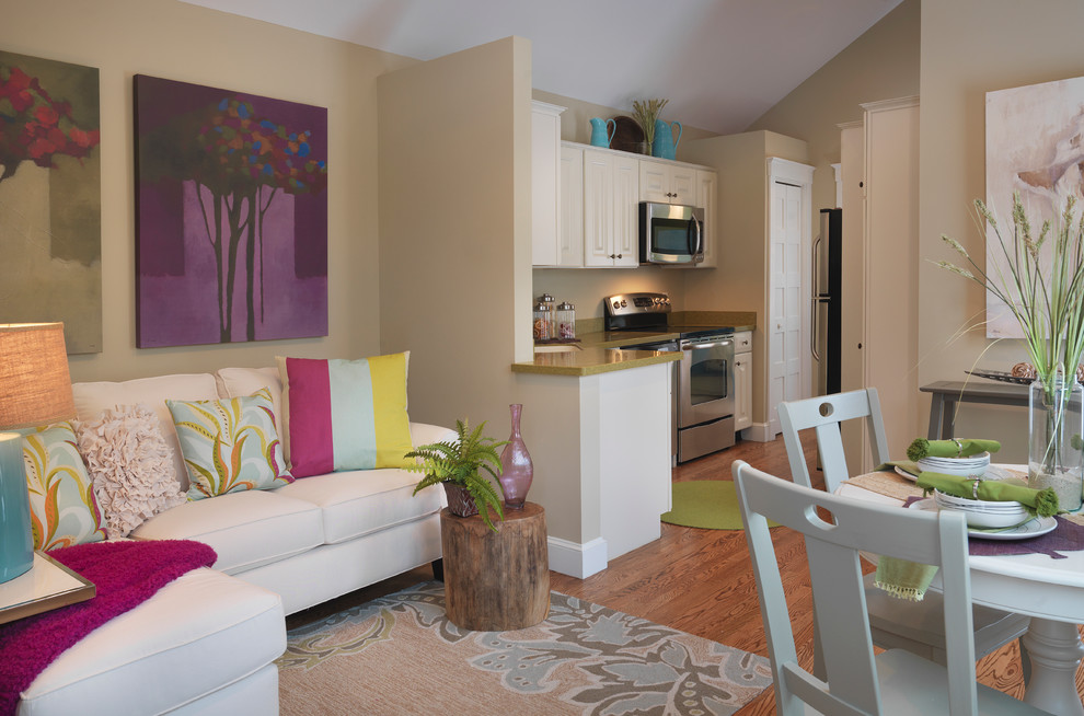 Inspiration for a small contemporary open concept medium tone wood floor living room remodel in Other with beige walls
