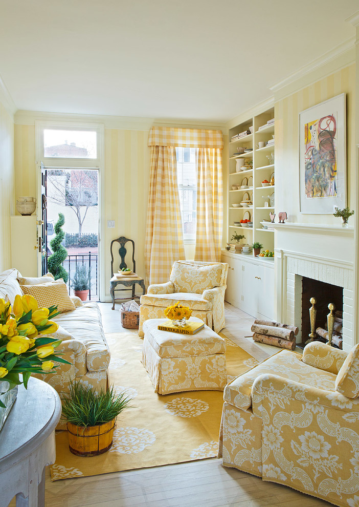 Elegant living room photo in DC Metro with yellow walls, a standard fireplace and a brick fireplace