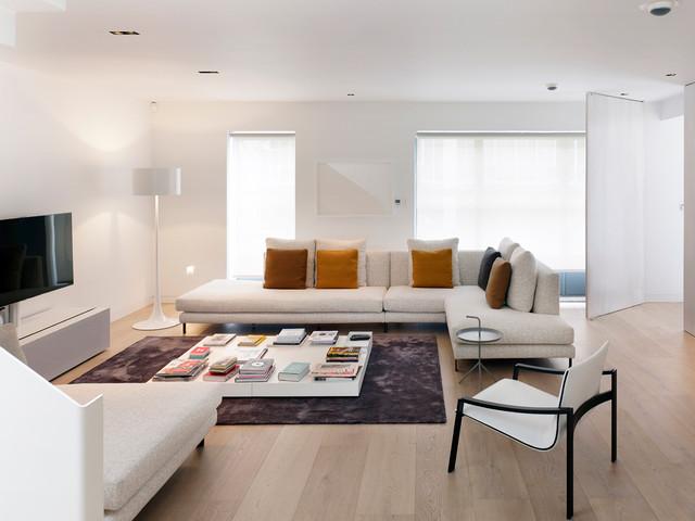 example of a danish formal light wood floor and beige floor living room design in london
