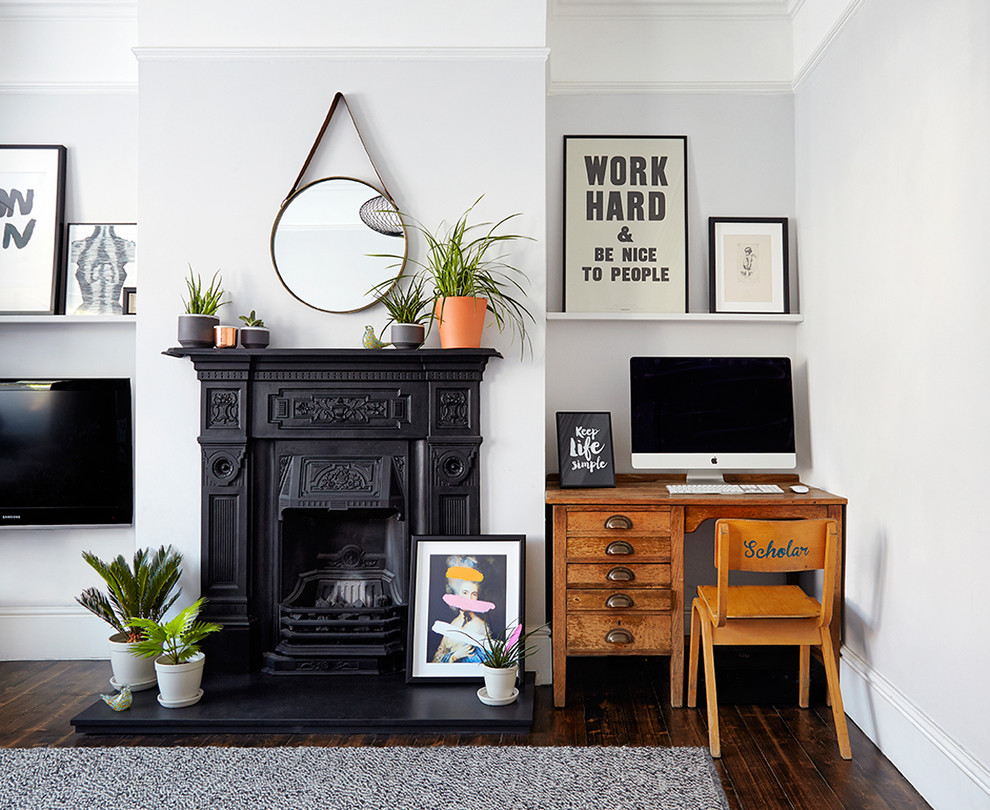 Inspiration for a mid-sized scandinavian formal and open concept dark wood floor living room remodel in London with white walls and a wall-mounted tv