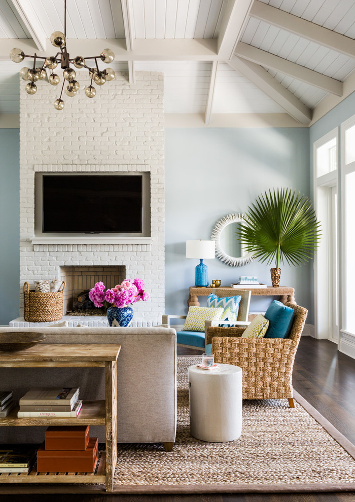 Beach style formal dark wood floor living room photo in Jacksonville with blue walls, a standard fireplace and a wall-mounted tv