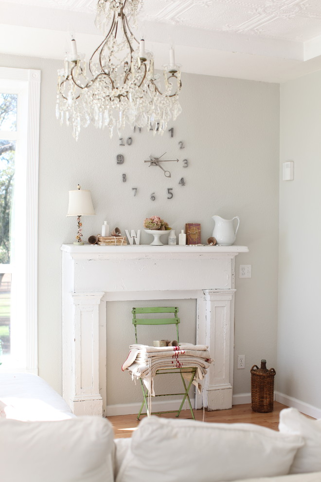 Example of a cottage chic living room design in Other with gray walls