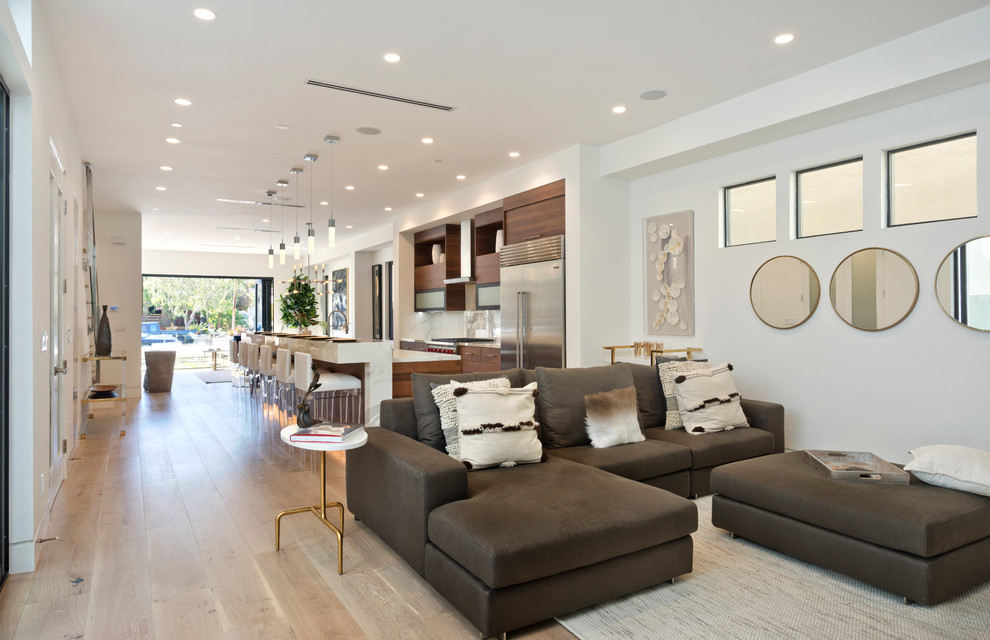 Living room - mid-sized mid-century modern formal and open concept light wood floor and beige floor living room idea in Orange County with white walls, no fireplace and no tv