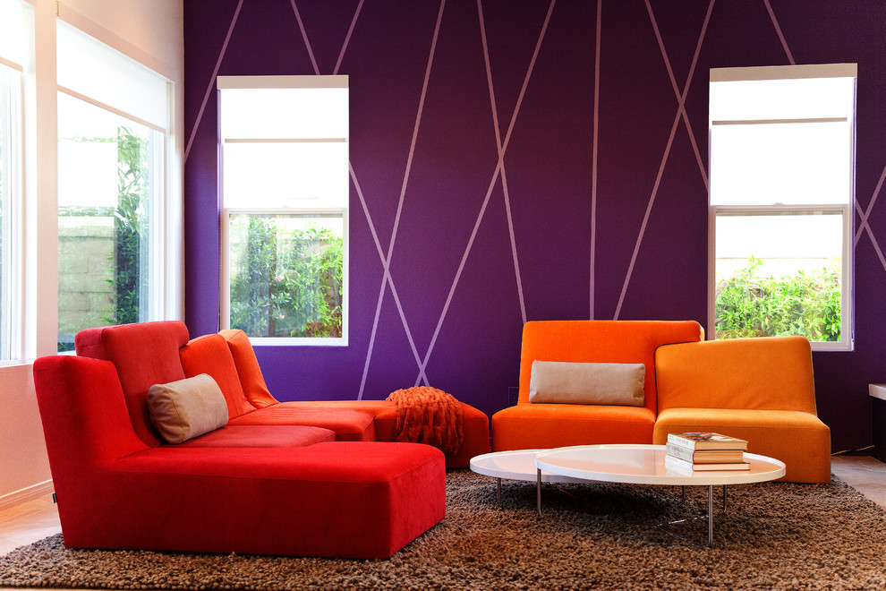 Inspiration for a modern living room remodel in Los Angeles with purple walls