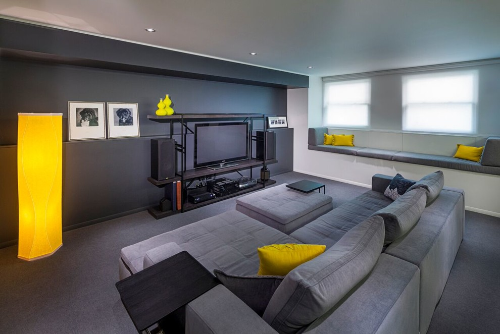 Example of a large minimalist open concept carpeted living room design in Chicago with black walls, a tv stand and a music area