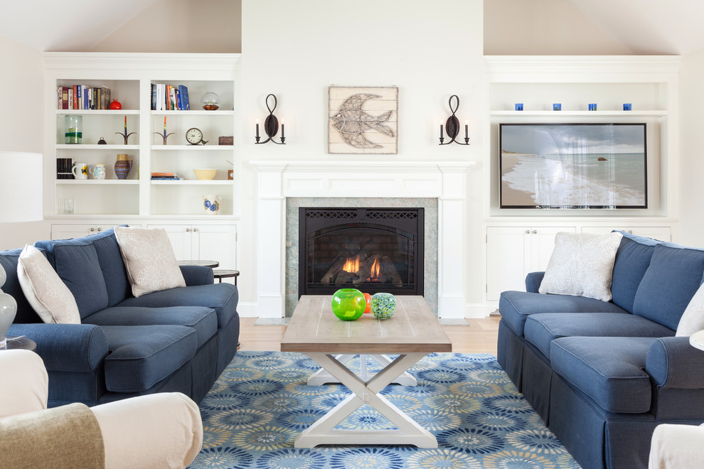 Beach style living room photo in Boston with a standard fireplace