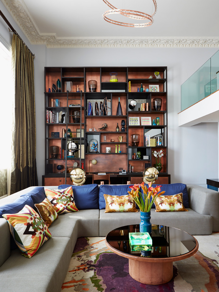 Living room - large contemporary open concept living room idea in London with gray walls