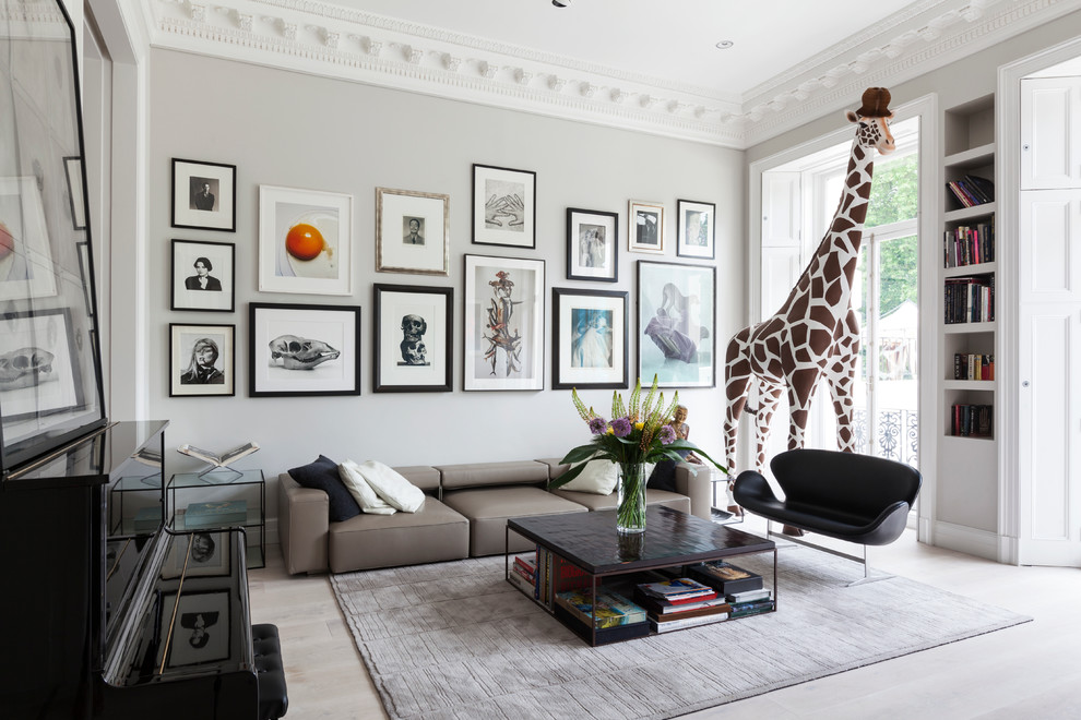 Living room - large contemporary formal and open concept light wood floor living room idea in London with gray walls