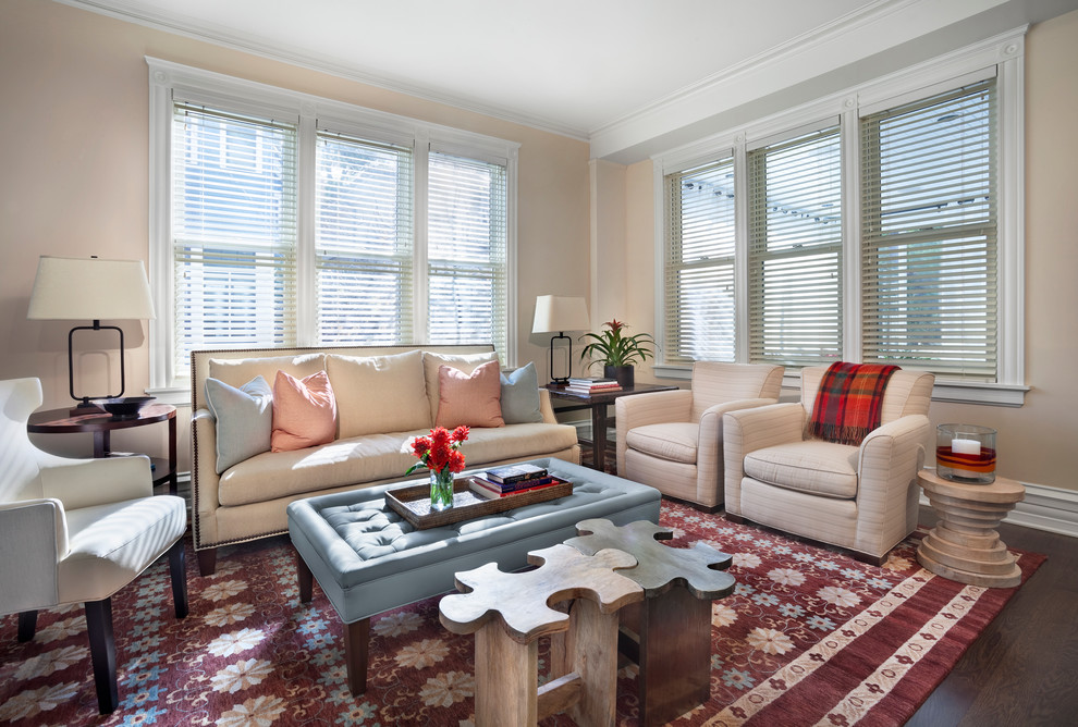 Example of a transitional dark wood floor living room design in Chicago with beige walls
