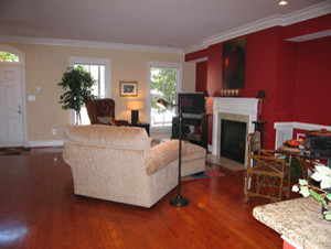 image painting sitting area fireplace red accent wall
