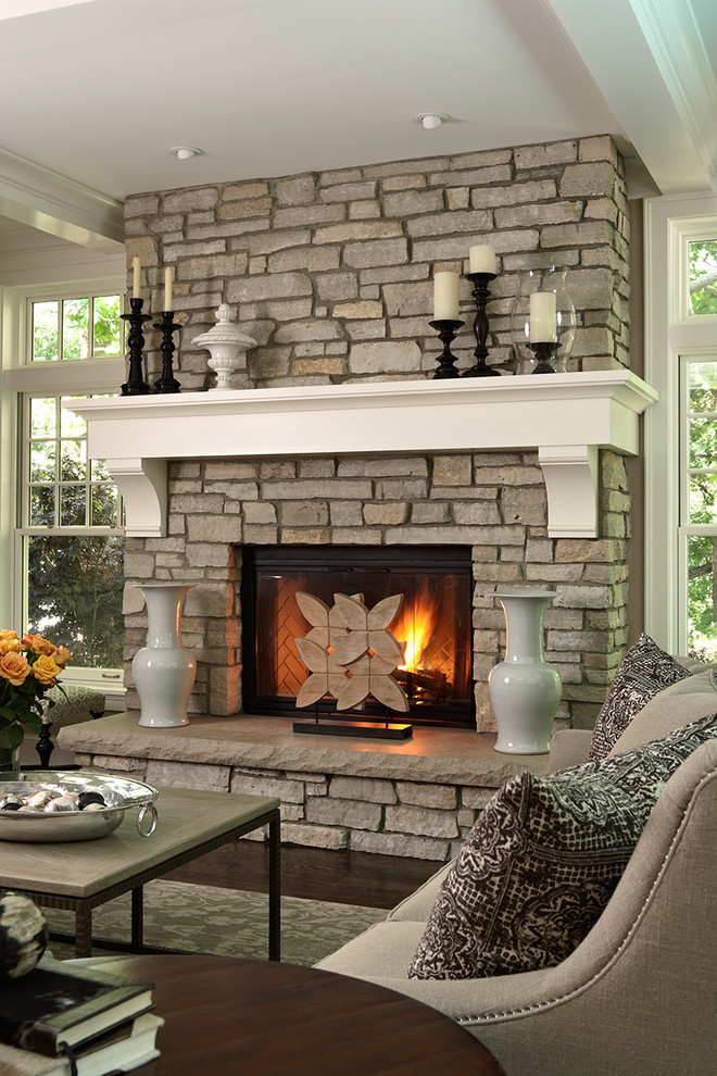 Elegant brown floor living room photo in Minneapolis with a standard fireplace