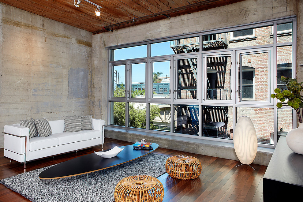 Example of an urban open concept dark wood floor living room design in Los Angeles with no fireplace