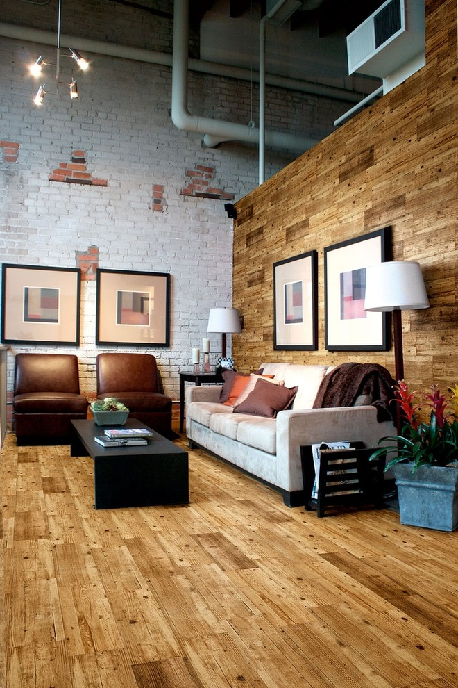 Inspiration for a mid-sized industrial open concept medium tone wood floor living room remodel in London with white walls